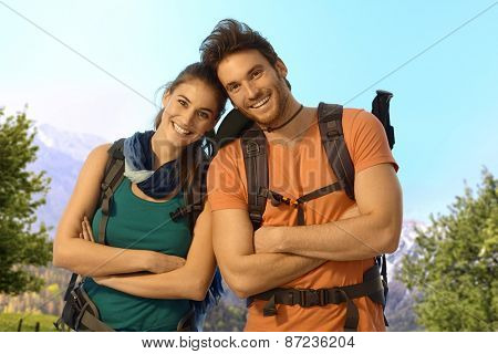 Portrait of young hikers outdoor on a sunny spring day, looking at camera, smiling.