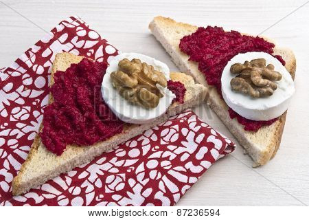 Sandwich With Red Beet Spread, Goat Cheese And Walnut