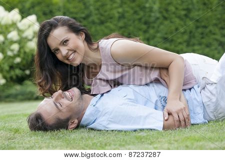 Playful young couple having leisure time in park