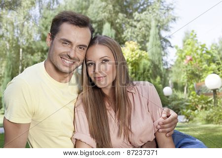 Portrait of beautiful young couple spending leisure time in park