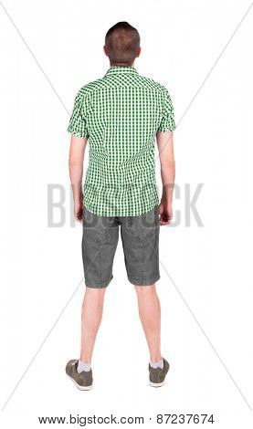 Back view of young man in shirt and shorts  looking.   Standing young guy. Rear view people collection.  backside view of person.  Isolated over white background.