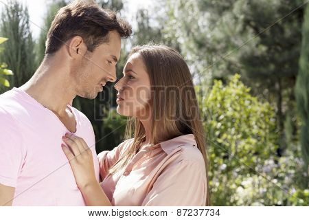 Side view of affectionate young couple looking at each other in park