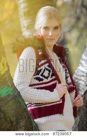 Portrait of beautiful woman in warm clothing standing in park