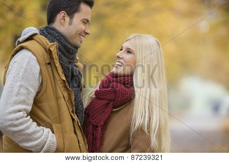 Happy couple looking at each other in park