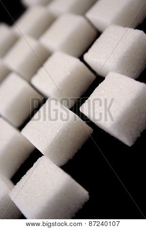 Lump sugar on black background