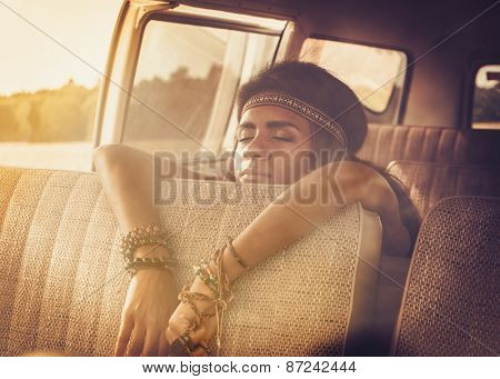 Young black hippie woman in a retro van