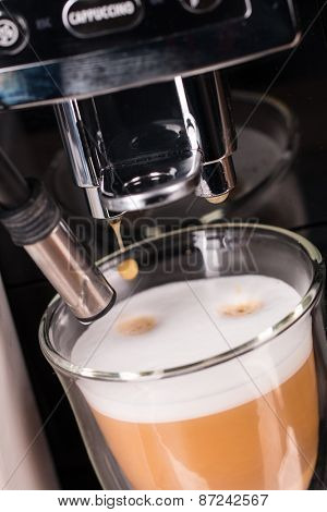 Detail of coffee machine making cappuccino