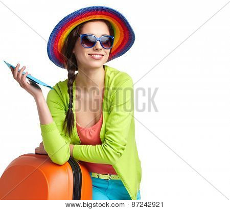portrait of female tourist with travel suitcase and boarding pass