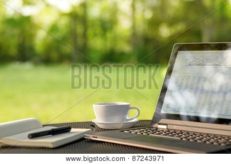 Laptop and coffee, outdoor office