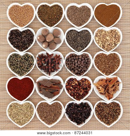 Middle eastern spice selection in heart shaped porcelain bowls.