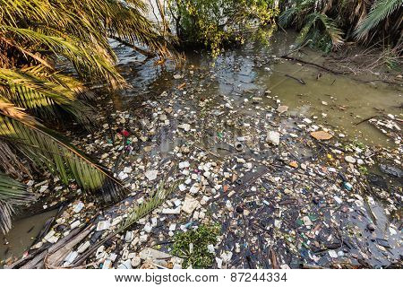 Water rubbish pollution with plastic and other floating stuffs in the chao phraya river in Bangkok, Thailand