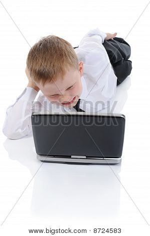 Wicked Boy Lying On The Floor With A Laptop.