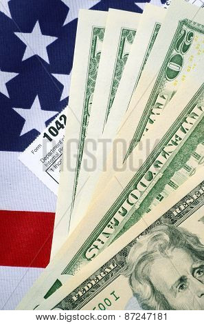Usa Tax Day Concept With Income Tax Form And Cash On Stars And Stripes Flag.