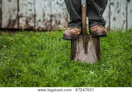 Details Of Feet And Shovel