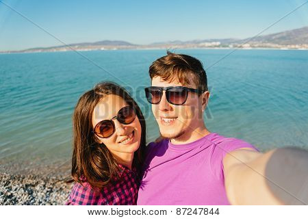 Happy Loving Couple Taking Self-portrait On Beach