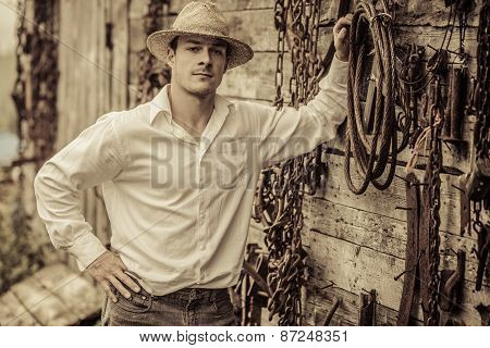 Farmer Portrait In Front Of A Wall Full Of Tools