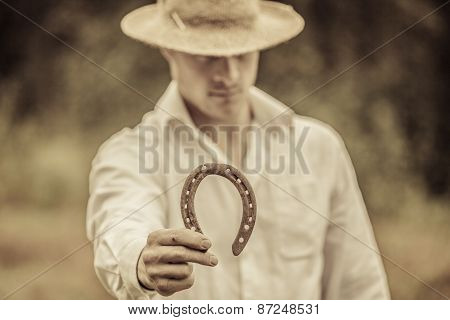 Lucky Farmer Holding A Horseshoe