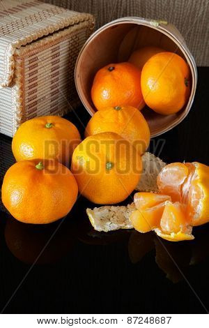 many tangerine on background wicker boxes with reflection