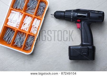 Screws Box And Screwdriver.
