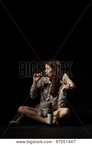 Beautiful Young Brunette Woman Drinking From Glass Of White Wine