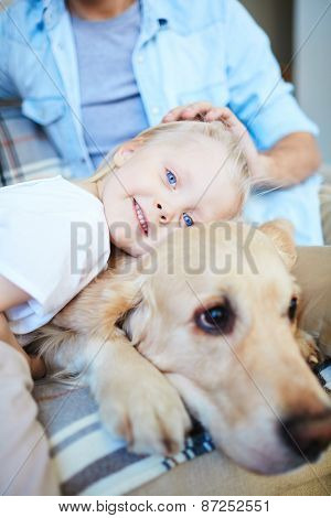 Cute little girl expressing affection to her pet