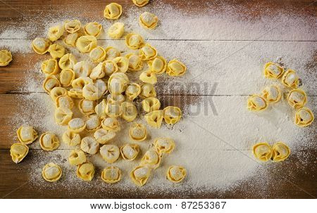 Freshly Made Ravioli On A  Wooden Background.