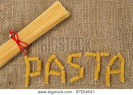 Pasta lying on rough canvas