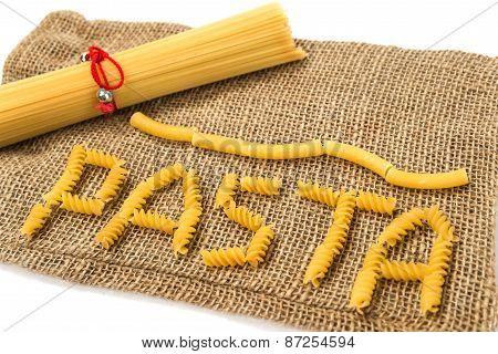 Pasta lying on rough canvas