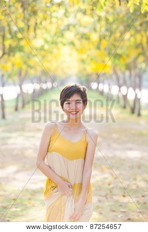 Portrait Of Young Beautiful Asian Woman Wearing Yellow Long Dress With Smiling Face ,happiness Emoti