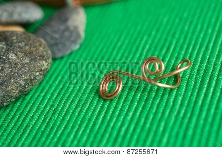Stones And Element From A Copper Wire