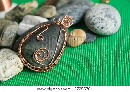 Pendent From The Stone Braided By A Copper Wire