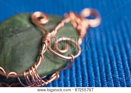 Handwork Pendent From A Stone And A Wire Close Up