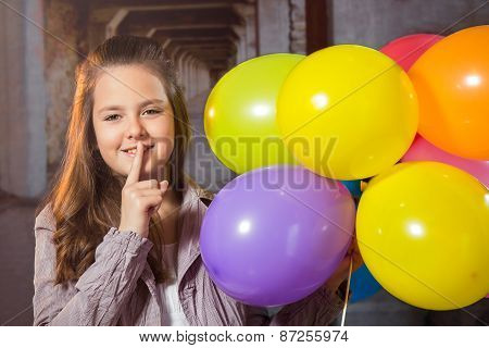 Ten year old caucasian girl with long hair posing in the studio