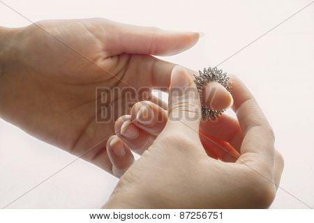 Woman's Hands With Massage Ring On A Finger