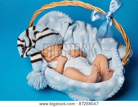 Newborn Baby Inside Basket, New Born Kid Dream In Woolen Hat, Little Child Boy Sleeping