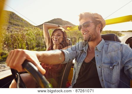 Cheerful Young Couple On Road Trip