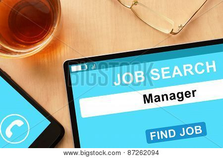 Tablet with Manager on job search site.