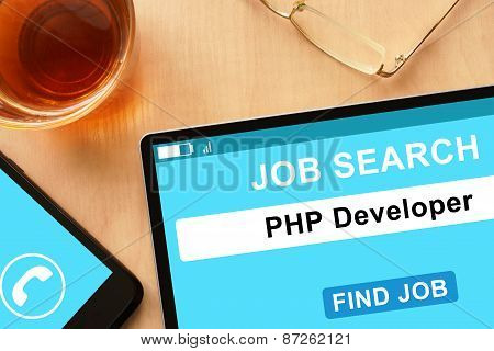 Tablet with PHP Developer on job search site.