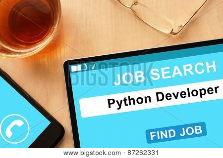 Tablet with Python Developer on job search site.