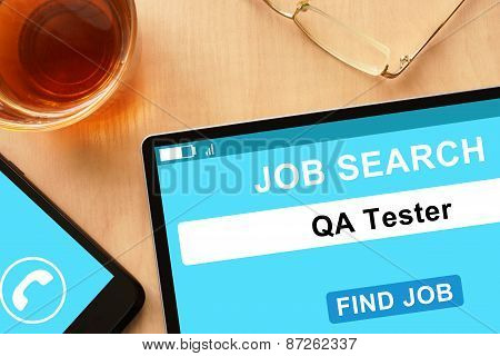 Tablet with QA Tester on job search site.
