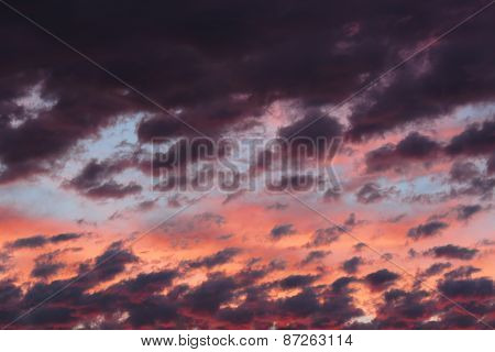 Clouds on sunset sky, background