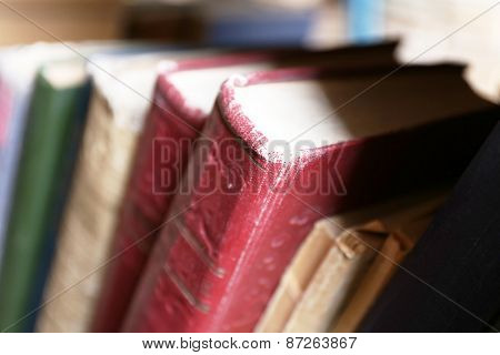 Old used books in library, closeup