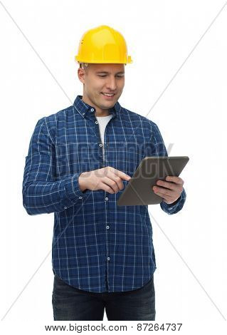 repair, construction, building, people and maintenance concept - smiling male builder or manual worker in helmet with tablet pc computer