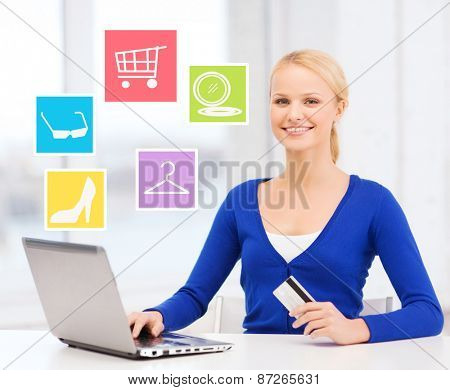 online shopping, sale and people concept - happy businesswoman with laptop and credit card at home