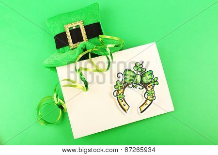 Greeting card for Saint Patrick's Day with leprechaun hat on green background