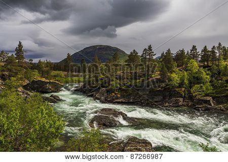 Beautiful Landscape With Mountain River And Clouds