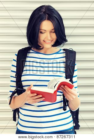 bright picture of attractive woman with bag and book..