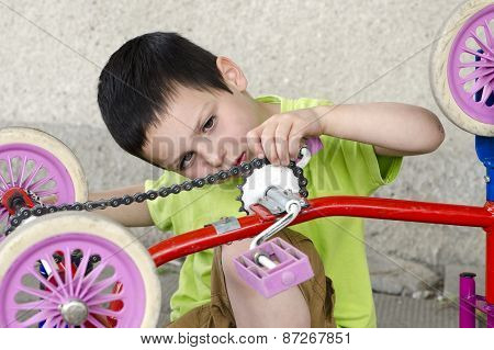 Child Mechanic Reparing