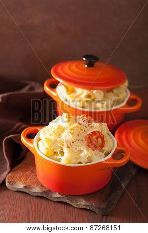 baked macaroni with cheese in orange casserole