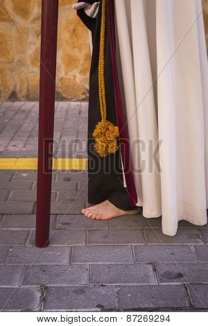 Penitent Carried A Wooden Cross In A Procession Of Holy Week, Seville, Andalusia, Spain